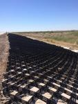 Photo No.1 Placing of geogrid and geotextile at section SP 926+00-SP927+00 on left side of the road
